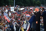 President Bill Clinton salutes supporters during a campaign stop for his re-election August 27, 1996 in Pontiac, MI