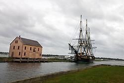 Friendship of Salem docked next to a boarded up saltbox style building, Salem Maritime National Historic Site, Salem, Massachusetts, United States of America