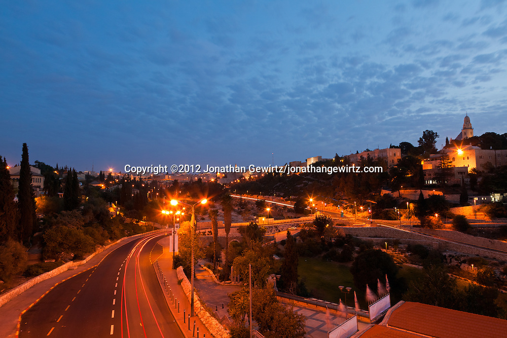 The walls of Jerusalem's Old City near the Jaffa Gate and Citadel of David overlook the Sultan's Pool and Derech Hevron in this pre-dawn view. WATERMARKS WILL NOT APPEAR ON PRINTS OR LICENSED IMAGES.