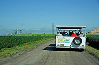 Northeast AgExpo attendees head out in trams to tour soy bean fields.