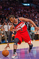 22 March 2013: Guard (2) John Wall of the Washington Wizards places the ball on the court against the Los Angeles Lakers late during the second half of the Wizards 103-100 victory over the Lakers at the STAPLES Center in Los Angeles, CA.