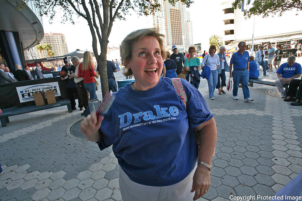 Drake fan Sally Robson brushed her hair after putting on her Drake t-shirt Friday at the St. Pete Times Forum, before the Bulldogs game against Western Illinois.
