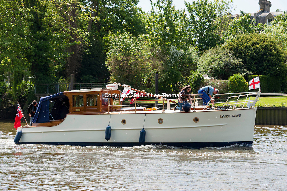 Teddington Locks, London, UK. 16th May 2015.  Pictured: Lazy Days sets off at a sedate pace down the Thames at Teddington. / Approximately 18 Dunkirk Little Ships set off from Teddington to France to commemorate the 75th Anniversary of Operation Dynamo in World War Two. Invited by the Mayor of Dunkirk, The Association of Dunkirk Little Ships has organised the event every 5 years since 1970 with this year likely to be the biggest return yet for the vessels now on average being close to 80 years old. Today (Saturday 16th May) the Little Ships set off to the Royal Docks in east London where a weekend of festivities will commemorate Operation Dynamo with departure for Ramsgate from Queenborough planned for Tuesday 19th May. The morning of the 21st of May (pending suitable weather conditions) sees the passage to Dunkirk, with vessels crossing one of the busiest shipping lanes in the world. It is expected that over 50 Little Ships escorted by the RNLI and the Royal Navy will take part in the Return.  // Lee Thomas, Flat 47a Park East Building, Bow Quarter, London, E3 2UT. Tel. 07784142973. Email: leepthomas@gmail.com www.leept.co.uk (0000635435)