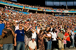 Spectators attend during the day nine of the 12th IAAF World Athletics Championships at the Olympic Stadium on August 23, 2009 in Berlin, Germany. (Photo by Vid Ponikvar / Sportida)