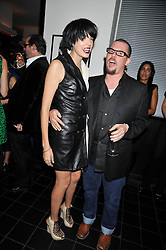 ALEXANDER McQUEEN and AGYNESS DEYN at a dinner hosted by Alexandra Shulman editor of British Vogue in association with Net-A-Porter.com to celebrate 25 years of London Fashion Week and Nick Knight held at Le Caprice, Arlington Street, London on 21st September 2009.