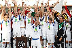 17.05.2014, Rhein-Energie Stadion, Koeln, GER, DFB Pokal, Frauen, 1. FFC Frankfurt vs SGS Essen, Finale, im Bild Kerstin Garefrekes (1. FFC Frankfurt #18) mit dem Pokal, mit Saskia Barusiak (1. FFC Frankfurt #25), Ana-Maria Crnogorceviz (1. FFC Frankfurt #21), Bianca Schmidt (1. FFC Frankfurt #23), Alina Garciamendez (1. FFC Frankfurt #2), Trainer Colin Bell (1. FFC Frankfurt - rechts) // during the woman DFB Pokal final match between 1. FFC Frankfurt and SGS Essen at the Rhein-Energie Stadion in Koeln, Germany on 2014/05/17. EXPA Pictures © 2014, PhotoCredit: EXPA/ Eibner-Pressefoto/ Schueler<br /> <br /> *****ATTENTION - OUT of GER*****