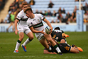 London Irish wing Ollie Hassell-Collins (11) looks to pass from the tackle during the Gallagher Premiership Rugby match between Wasps and London Irish at the Ricoh Arena, Coventry, England on 20 October 2019.