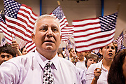 "July 2 - PHOENIX, AZ: MICHEL CHERGUI, originally from France, becomes a US citizen during a naturalization ceremony Friday. Nearly 200 people were sworn in as US citizens during the ""Fiesta of Independence"" at South Mountain Community College in Phoenix, AZ, Friday. The ceremony is an annual event on th 4th of July weekend and usually the largest naturalization ceremony of the year in the Phoenix area.  Photo by Jack Kurtz"
