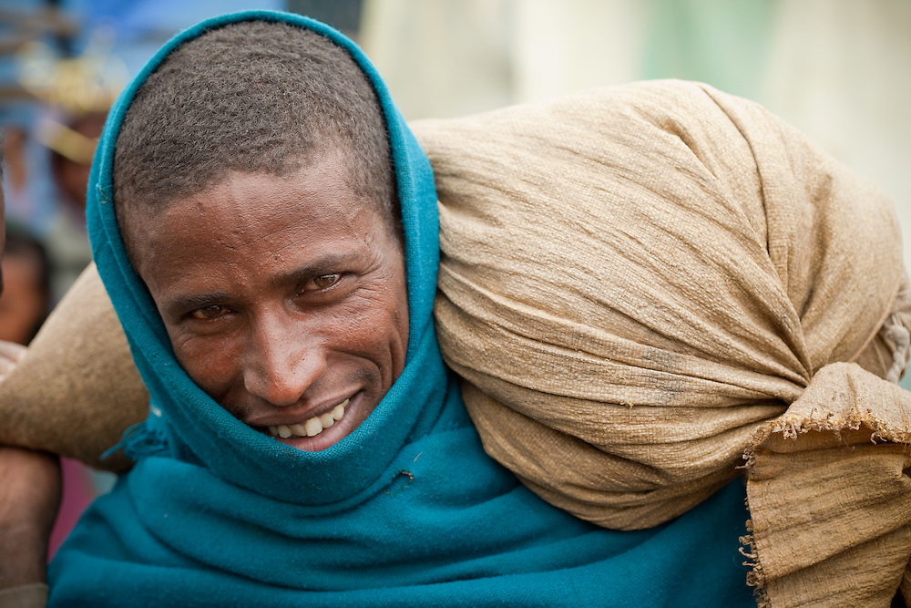 Man carrying produce to Market day in Mehal Meda on the Guassa Plateau in the Ethiopian Highlands