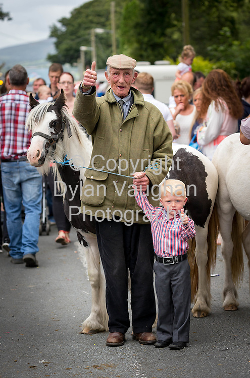 15-8-15<br /> <br /> Larry Gannon from Bunclody Co. Wexford and Gerry Connors aged 3 from Bunclody Co. Wexford pictured at the annual Borris Horse Fair in Borris Co. Carlow over the weekend.<br /> <br /> <br /> Picture Dylan Vaughan.