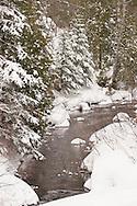A snowy river nature scene near Copper Harbor Michigan in winter.