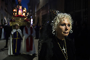 A penitent dressed in traditional andalusian costume. Procession of Good Friday considered<br /> Cultural Heritage of Mataró city (Barcelona, Spain) since 2013.  Easter 2015. Eva Parey/4SEE