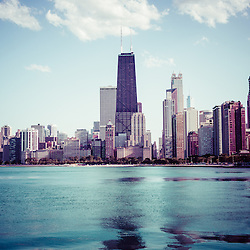 High resolution picture of Chicago with Instagram style tone. Picture includes the Hancock building and other popular downtown Chicago city buildings. The John Hancock Center building is one of the world's tallest skyscrapers and is a famous fixture in the Chicago skyline. Photo is high resolution and was taken in 2012.