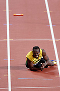 Great Britain, London - 2017 August 12: Usain Bolt of Jamaica reacts after falling to the track while men's 4x100m relay final during IAAF World Championships London 2017 Day 9 at London Stadium on August 12, 2017 in London, Great Britain.<br /> <br /> Mandatory credit:<br /> Photo by &copy; Adam Nurkiewicz<br /> <br /> Adam Nurkiewicz declares that he has no rights to the image of people at the photographs of his authorship.<br /> <br /> Picture also available in RAW (NEF) or TIFF format on special request.<br /> <br /> Any editorial, commercial or promotional use requires written permission from the author of image.