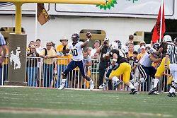 Virginia quarterback Jameel Sewell (10) passes against Wyoming.  The Wyoming Cowboys defeated the Virginia Cavaliers 23-3 at War Memorial Stadium in Laramie, WY on September 1, 2007.