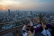 Downtown Bangkok and Chao Phraya River at sunset seen from Banyan Tree Hotel's Vertigo Grill & Moon Bar on the 61st floor.