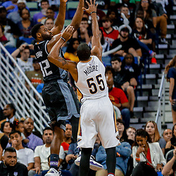 Mar 31, 2017; New Orleans, LA, USA; Sacramento Kings guard Tyreke Evans (32) shoots over New Orleans Pelicans guard E'Twaun Moore (55) during the second half of a game at the Smoothie King Center. The Pelicans defeated the Kings 117-89. Mandatory Credit: Derick E. Hingle-USA TODAY Sports