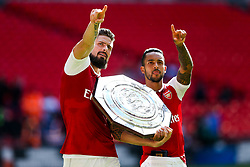 Olivier Giroud and Theo Walcott of Arsenal point up to the family boxes as they celebrate after winning the penalty shootout to lift the Community Shield - Rogan Thomson/JMP - 06/08/2017 - FOOTBALL - Wembley Stadium - London, England - Arsenal v Chelsea - FA Community Shield.