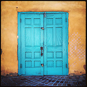 The colors of New Mexico: turquoise door at Old Town Emporium in Albuquerque.