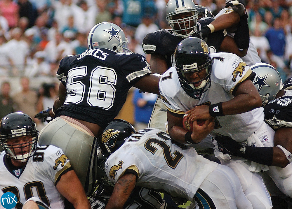 Jacksonville quarterback Byron Leftwich (7) dives into the endzone to give the Jaguars the lead over the Dallas Cowboys Sunday at Alltel Stadium. The Jaguars held on to beat the Cowboys 28-17 in their season opener.