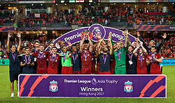 HONG KONG, CHINA - Saturday, July 22, 2017: Liverpool's captain Jordan Henderson lifts the trophy after beating Leicester City 2-1 during the Premier League Asia Trophy final match between Liverpool and Leicester City at the Hong Kong International Stadium. Roberto Firmino, Nathaniel Clyne, Philippe Coutinho Correia, Alberto Moreno, Danny Ward, Ben Woodburn, Joel Matip, Trent Alexander-Arnold, Daniel Sturridge, Divock Origi, captain Jordan Henderson, Daniel Sturridge, Marko Grujic, (Pic by David Rawcliffe/Propaganda)