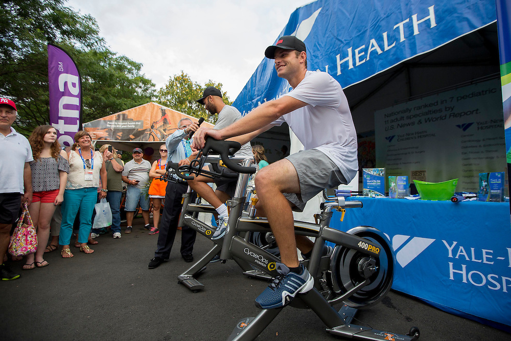 August 21, 2014, New Haven, CT:<br /> James Blake and Andy Roddick ride spin bikes for Yale New Haven Health during the Men's Legends Event on day seven of the 2014 Connecticut Open at the Yale University Tennis Center in New Haven, Connecticut Thursday, August 21, 2014.<br /> (Photo by Billie Weiss/Connecticut Open)