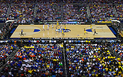 The University of Michigan Wolverines bring the ball up the court against the University of Kansas Jayhawks during the NCAA South Regionals at Cowboys Stadium in Arlington on Friday, March 29, 2013. (Cooper Neill/The Dallas Morning News)