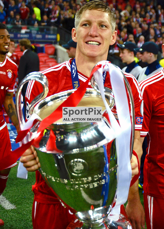 Bayern Munich's Bastian Schweinsteiger celebrates with the trophy - Borussia Dortmund v FC Bayern Munich UEFA Champions League Final Wembley Stadium 25 May 2013 (c) Greig Bertram | StockPix.eu