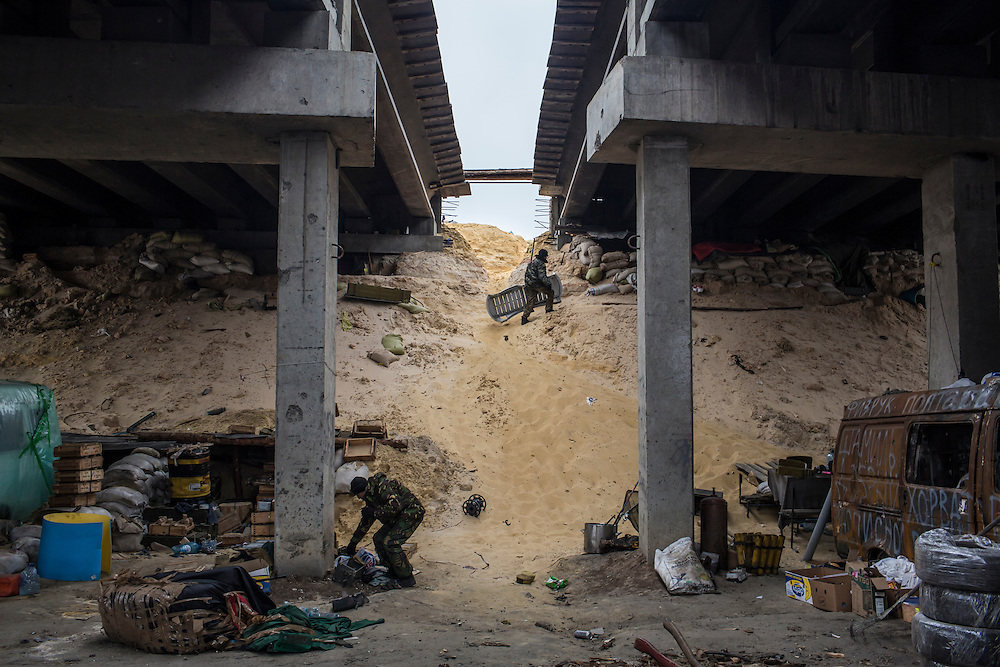 PERVOMAISKE, UKRAINE - NOVEMBER 18, 2014: Members of the 5th platoon of the Dnipro-1 brigade, a pro-Ukraine militia, at their post underneath a bridge in Pervomaiske, Ukraine. CREDIT: Brendan Hoffman for The New York Times
