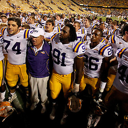 Sep 18, 2010; Baton Rouge, LA, USA; LSU Tigers head coach Les Miles joins his players in singing the Tigers fight song following a win over the Mississippi State Bulldogs at Tiger Stadium. The LSU Tigers defeated the Mississippi State Bulldogs 29-7. Mandatory Credit: Derick E. Hingle