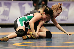 London, Ontario ---2013-03-02---    Hayley Thomas of  University Of Alberta takes on  Hannah Franson of  U Of Sask in the women's 55 KG bronze medal match at the 2012 CIS Wrestling Championships in London, Ontario, March 02, 2013. .GEOFF ROBINS/Mundo Sport Images