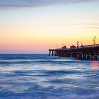 San Clemente pier at sunset panorama photography. Panorama photo ratio is 1:3. San Clemente California is a popular coastal city in Orange County in the United States of America. Copyright ⓒ 2017 Paul Velgos with all rights reserved.