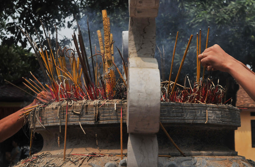 Incense is offered in Buddhist culture much like our Native American ceremony of smudging - as an offering to Buddah/Creator and a tool for purifying the surrounding area .  Hanoi, Vietnam, Oct. 09, 2010  (Laura Fong Torchia/Special to the Akron Beacon Journal)