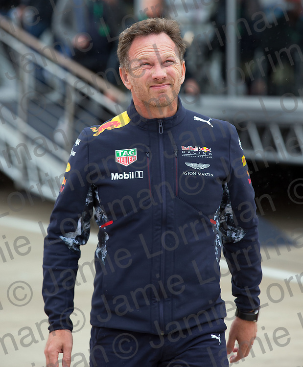 The 2017 Formula 1 Rolex British Grand Prix at Silverstone Circuit, Northamptonshire.<br /> <br /> Pictured: Red Bull team principal Christian Horner looks to the rain clouds ahead of qualifying at Silverstone Circuit.<br /> <br /> Jamie Lorriman<br /> mail@jamielorriman.co.uk<br /> www.jamielorriman.co.uk<br /> +44 7718 900288