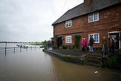 © London News Pictures. 01/05/2012. Tewkesbury, UK. Houses close to flood water in Tewkesbury, Gloucestershire, England on May 1, 2012. The UK has had its wettest April in over a century, with some areas seeing three times their usual average rainfall, according to figures from the Met Office. Photo credit : Ben Cawthra /LNP