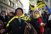 about 1000 supporters of  Tshisekedi having a anti-Kabila protest in the heart of Brussels, ending in chaos and arrests. ©Reporters/sanderdewilde In this pic: two congoleze women with flags of Flanders, Black Lion on yellow.