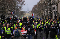 19 January 2019. Paris, France.<br /> Gilets Jaunes - Acte X take to the streets of Paris. An estimated 7,000 people took part in the looping 14 km route from Place des Invalides to protest tax hikes from the Government of Emmanuel Macron imposed on the people. An estimated 80,000 people took part in protests across the country. Regrettably the movement has attracted a violent element of agitators who often face off with riot police at the end of the marches which tends to deflect attention away from the message of the vast majority of peaceful protesters.<br /> Photo&copy;; Charlie Varley/varleypix.com