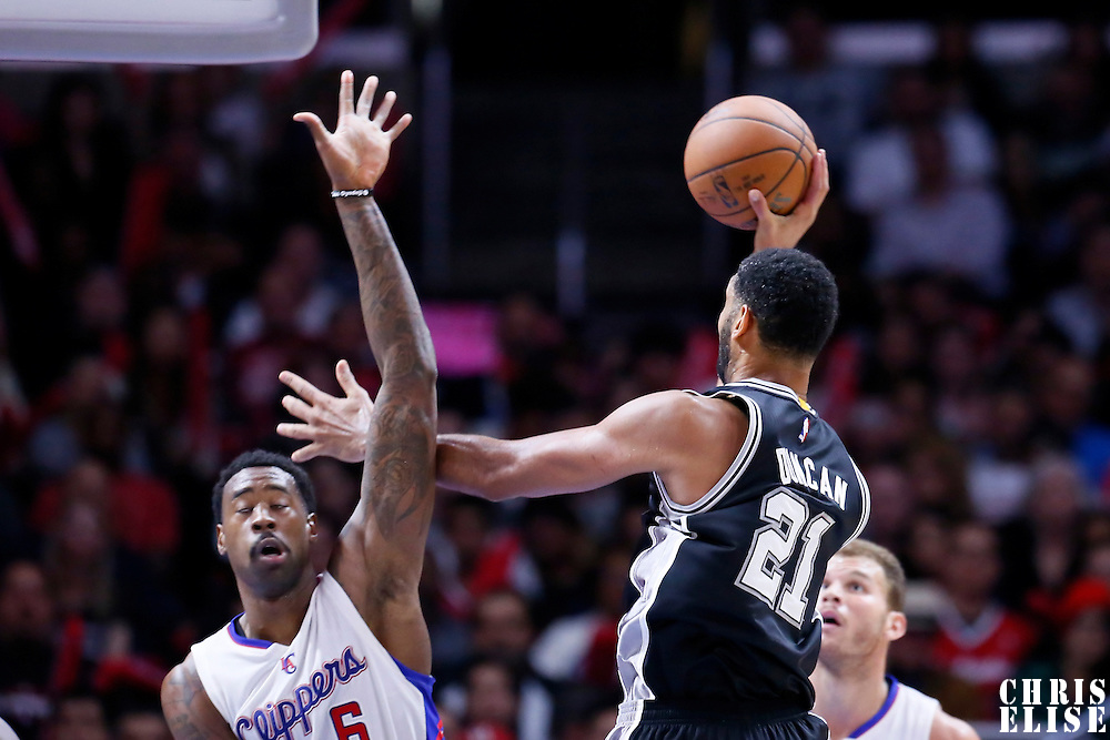 10 November 2014: San Antonio Spurs forward Tim Duncan (21) goes for the jump shot over Los Angeles Clippers center DeAndre Jordan (6) during the San Antonio Spurs 89-85 victory over the Los Angeles Clippers, at the Staples Center, Los Angeles, California, USA.