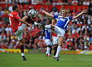 Dimitar Berbatov of Manchester United fights for the ball with Sebastian Larsson of Birmingham City during the Barclays Premier League match between Manchester United and Birmingham City at Old Trafford on August 16, 2009 in Manchester, England.