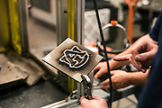 "AUBURN, AL – NOVEMBER 20, 2016: Conyers Coupland, 23, shows his professor an Auburn University logo he printed out of solid metal using a process called Wir3D, an additive manufacturing technique comparable to MIG welding that continuously melts metal wire in an electric arc. ""It's essentially like feeding a wire into a lightweight bolt,"" Coupland said. The head that continuously feeds the wire is animated by a computer, on which the design is loaded. Coupland is pursuing a masters degree in mechanical engineering under Dr. Lewis Payton, who started Auburn's Design and Manufacturing Laboratory in 2007. <br /> <br /> In much of the United States, global trade and technological innovation has failed to produce the prosperity hoped for by political and business leaders. Yet despite formidable economic challenges, some localities are flourishing. In Lee County, Ala., unemployment is below the national average despite the loss of thousands of manufacturing jobs, and the key to the county's resilience may be Auburn University, which provided a steady source of employment during recessions and helped draw new businesses to replace those that fled. CREDIT: Bob Miller for The Wall Street Journal<br /> [RESILIENT]"