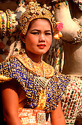 THAILAND, BANGKOK Traditionally dressed Thai dancer on grounds of Wat Arun Temple