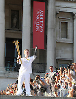 LONDON - JULY 26: Olympic Torch Relay, Trafalgar Square, London, UK. July 26, 2012. (Photo by piQtured)