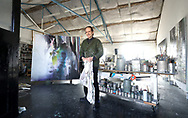 "LONDON, ENGLAND - MARCH 15:  Artist Justin Mortimer poses for a photo in his studio ahead of his new exhibition on 15, March 2017 in London, England.  ""It Is Here"" is a new collection of atmospheric canvases depicting war, protest and social unrest by acclaimed British painter Justin Mortimer.  He began his career as a portrait painter and notable people who have sat for him include The Queen, David Bowie and Sir Steve Redgrave. The free exhibition runs from 30 March at London's Parafin gallery.  (Photo by Tim P. Whitby/Getty Images)"