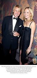 MR JOE BAMFORD son of Sir Anthony Bamford and REBECCA COLLINS, at a party in London on 12th September 2002.	PDE 525