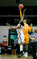December 22, 2009; San Francisco, CA, USA;  Tennessee Lady Volunteers forward Glory Johnson (25) wins the opening tip off from San Francisco Dons forward Donnisha Taylor (20) during the first half at War Memorial Gym.  Tennessee defeated San Francisco 89-34.
