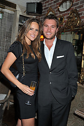 BEN CARING and his wife ELLE at an afternoon tea party in aid of the Naked Heart Foundation held at Mari Vanna, Wellington Court, 116 Knightsbridge, London on 29th August 2012.