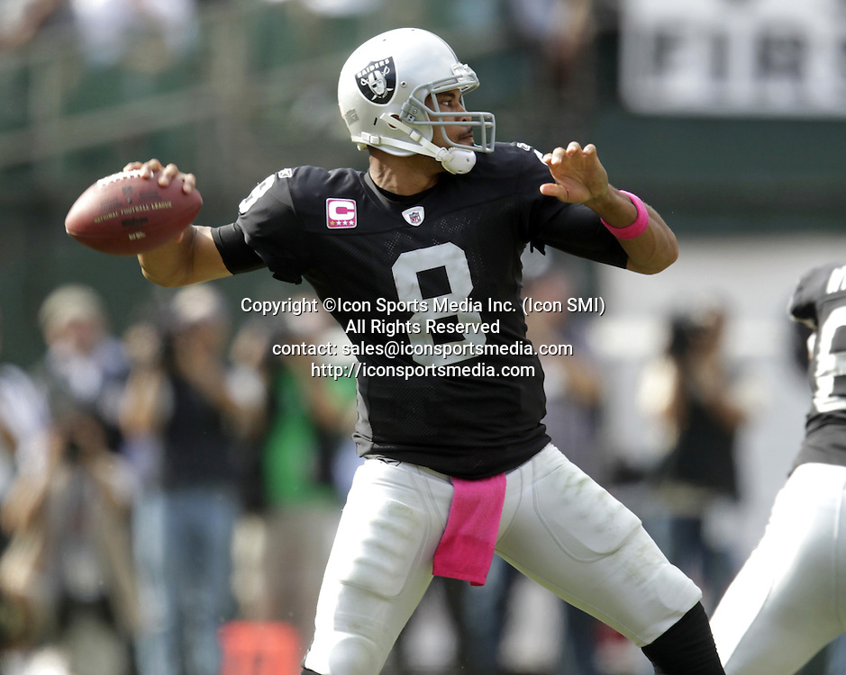 Oct. 2, 2011 - Oakland, CA, USA - Oakland Raiders quarterback Jason Campbell (8) throws against the New England Patriots in the fourth quarter at the O.co Coliseum in Oakland, California, Sunday, October 2, 2011. The Patriots defeated the Raiders, 31-19