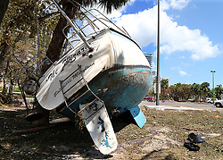 A damaged sail boat washed ashore in the Grove Key Marina parking lot in Miami, after Hurricane Irma passed over South Florida, on Tuesday, September 12, 2017. Photo by Pedro Portal/El Nuevo Herald/TNS/ABACAPRESS.COM