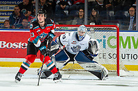 KELOWNA, BC - NOVEMBER 20:  Jake Poole #23 of the Kelowna Rockets looks for the pass in front of the net of Brock Gould #33 of the Victoria Royals at Prospera Place on November 20, 2019 in Kelowna, Canada. (Photo by Marissa Baecker/Shoot the Breeze)