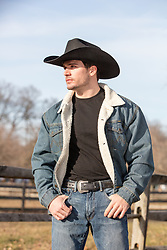 hot cowboy in a fleece lined denim jacket out on a ranch